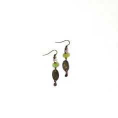 Beaded Oval Earrings, $24. Beautiful opalescent earrings, oval in shape and small in size. Featuring bronze metal work and handcrafted by a North Carolina artist.