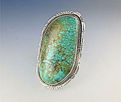 Ring Native American Pilot Mountain Turquoise Signed R. American Indian Sterling Silver Pilot mountain Ring Adjustable and 3 inches along he Finger  Signed R..  Condition: Excellent  Size: Free Size Adjustable 3 inches along the Finger  Type: Ring Native American Pilot Mountain Turquoise Signed R.  Country of Origin: US  Manufacturer: Pilot Mountain Turquoise Sterling Silver USA  Author: R