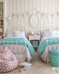 I like the names on bunting above beds. Maybe a long skinny table that could butt up against the window and house storage under it?  shared room - http://lastenvaltakunta.blogspot.fi/