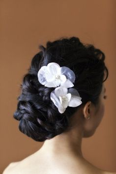 Wedding updo for brunette with white rose.