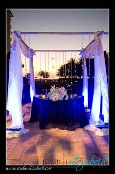 Beach Chic Wedding Sweetheart Table Wedding Planning: Peacock Premier Events Lighting: Rays Of Light Floral: Floral Design By Yamir Linens: Over The Top Inc.