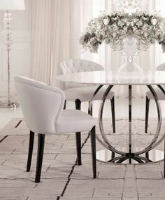 Creating a dramatic effect with the white collection dining set. A delightful round table topped with white marble and a silver contemporary chrome base. Contrasting elements that work perfectly together to create a striking form. Marble Top Dining Table, Glass Round Dining Table, Dining Set, Round Glass, Dining Room Design, Dining Room Chairs, Dining Tables, White Leather Dining Chairs, Dining Room Inspiration