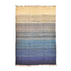 100% Jute Keira Rug. Color: Blue and ecru      Features:   Artistically hand-dyed    Hand-woven          Dimensions: 6 x 9
