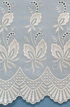 Cream net curtains with a simple design.
