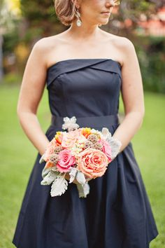 black bridesmaids dress with pastel bouquet.