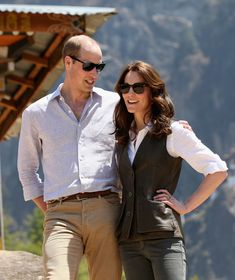 Prince William, Duke of Cambridge and Catherine, Duchess of Cambridge pose next to a prayer wheel on the trek up to Tiger's Nest during a visit to Bhutan on the 15th April 2016 in Thimphu, Bhutan.