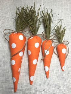 In the trendy Buffalo Check, your bunnies are going to need some Easter Carrots! Here our sweet fabric carrots will feed your Easter Bunny decor in fun polka dot or buffalo check plaid style! Easily tuck these carrots into your Spring Decor or Easter Basket! SIZE: Carrots range in size from the baby