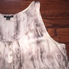 Sleeveless blouse Pink white gray patterned blouse. Slight high low hem with a loose overall fit. jcpenney Tops Tank Tops