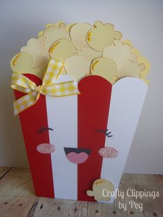 I am just in love with this adorable popcorn gift card holder! It measures approximately 4 x 5.5. This darling popcorn shaped card was a