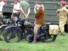 https://flic.kr/p/6Q2F7K | Royal Enfield | Royal enfield in pristine condition with WWIi Black out light fitted.  The Lady Rider is in Authentic costume of the day. Headcorn Aerodrome Military show 2009