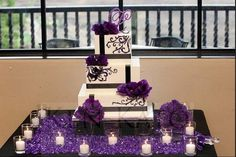 Purple and white contemporary cake with accenting damask print and purple flowers