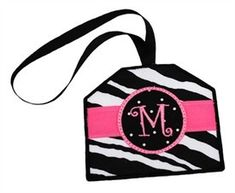 """Boutique Luggage Tags In the Hoop - Boutique Luggage Tags will make your luggage stand out from the rest! They feature a pocket on the back to keep your identity and personal information private. This fabulous In the Hoop design coordinates with our other Boutique Designs so you can make gorgeous matching sets - great for gifts! Hoop size: 4x4Design size: 3.91"""" x 3.34""""Stitch count: 5,178 Design is delivered  instantly  in the following formats: ART, HUS, PES, JEF, VIP, EXP, DST."""
