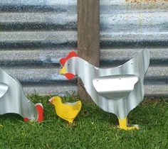 This wonderful 6 piece consists of:  1x Rooster  2x Hens  3x Baby Chicks    This chicken family is constructed of brand new (not recycled) corrugated iron.    Dimensions:    Rooster: 38cm x 5cm x 35cm  Chicken (standing) 33cm x 5cm x 29cm  Hen (feeding) 33cm x 5cm x 34cm  Baby Chicks (each) 12cm x 5cm x 12cm    + Very 'cheep' to feed.  + No mess to clean up after.  + No early morning crowing.  + Not very good layers though.