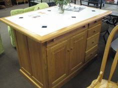 Free-standing kitchen island with white and blue tile, oak trimmed edge top, natural oak base with ample storage featuring doors on two sides $1,099. Available in-store   Amish-craftsmanship, comparable at $2,200