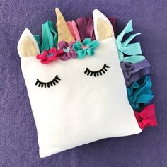 Grab the free pattern and make this unicorn fleece pillow! Fun and comfy! #Pillow