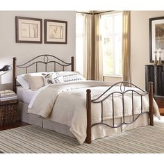 Update your entire bedroom lookwith this bed.  Round solid wood posts done in a dark walnut rich furniture finish are topped with elegant wood ball finials, while  headboard and footboard are done in multi-step powdercoat finish called 'mink'.