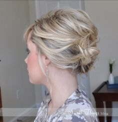 Mother of the Brides hair. Softly pinned back. Hair type = short brunette, thick wavy hair.