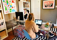 """Office for 2: """"Online art gallery owner Sonja Teri's Los Angeles apartment uses light-blue Eames Molded Plastic Side Chairs with Wire Bases on opposite sides and ends of a long desk-not too close, but not too far apart."""""""