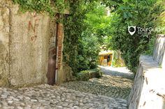 Colorful nature surround the cobblestone pathways on the streets of Old Town in Mostar.  Visit our website: www.tourguidemostar.com #travel #explore #stone #stonewalls #cobblestones #tourguidemostar #globaltrekker