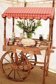 Rustic candy car old fashioned cart Could also be used as a wedding cake or cupcake table or iced teas station Sweet Cupcake Table, Dessert Table, Rustic Candy Bar, Sweet Carts, Gold Bar Cart, Candy Cart, Flower Cart, Food Stations, Wedding Candy