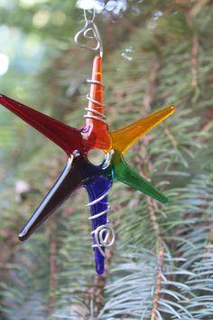 Colorful fused glass star ornament or sun catcher.
