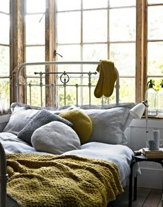 cozy yellow and grey bedroom