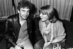 John Deacon of Queen and journalist Annemarie den Daas (of Dutch music magazine Hitkrant) on board a train (De Kameel) from Leiden to Amsterdam, Netherlands, after a gig at Groenoordhal, Leiden, April by Rob Verhorst Brian May, John Deacon, Great Bands, Cool Bands, Roger Taylor, Queen Freddie Mercury, Queen Band, Killer Queen, Music Magazines