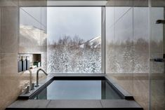 One of only five global Ritz-Carlton Reserves (and Japan's first), the ski-in, ski-out resort features a warmly modern take on alpine aesthetics: a fire blazes in a circular stone table in the lobby, ringed by curved butter-soft leather seating, textured stonework, and iridescent rainbow streaked ceramic pots. But the main protagonist is always Mount Yotei: bursting through every wall of glass is its cartoon-perfect triangular form fringed in pencil-sketch-like trees.