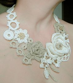 Ivory and light beige flowers crochet necklace .