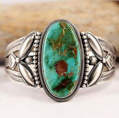 Stacey Gishal is a Navajo Silversmith who creates stunning Native American jewelry in the old style of the 1930's and 40's. This cuff has been set with a Natural Royston Turquoise stone with amber matrix, and crowned with sophisticated sterling silver applique work. | eBay!