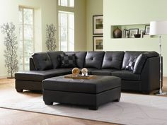 Attractive Decor Living Room To Black Leather Sectional Sofa With Green Wall Paint Color And White Large Rugs Under Coffee Table Also Using Floor Lamps