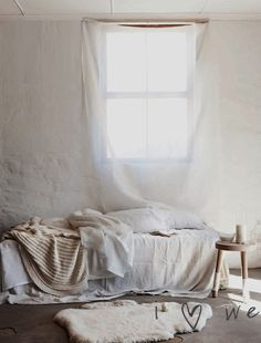 {moody} careless + light, relaxed + opportune to be yourself - white, cream, neutral, bed, window, sheer, white wall, light, sun, area rug, interiors styling -