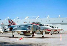 """A lineup of USN VF-111 """"Sundowners"""" Fighter Squadron F-4N Phantoms at their base."""