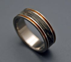 Enter love. Warm bronze pinstripes compliment dark California Buckeye in this unique band. Kissed with a satin finish. Pictured at 6.4mm.