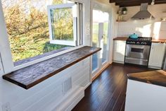 There are several design elements of this TH that I like.  I would switch the fold down counter into the kitchen and the french doors into the other space.