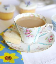 Vintage teacup with blue stripes and pink flowers