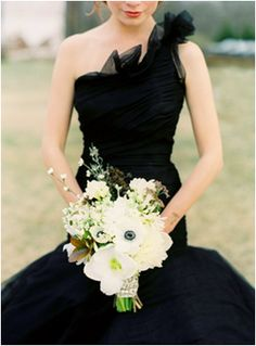 "this is one from of the earliest ""styled shoots"" we did years ago. this is emily (in the freezing cold) in a black ramona kaveza gown. photographed by jose villa, flowers and styling by joy thigpen."
