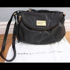 """Marc by Marc Jacobs Classic Q Messenger Bag A timeless brand classic in pebbled leather, this crossbody bag features a soft, relaxed silhouette with ample storage for all your on-the-go essentials. Adjustable crossbody strap, 18""""-22"""" drop Snap flap closure One outside zip pocket at flap One inside zip pocket Two inside open pockets Fully lined 11""""W X 9""""H X 2""""D Leather Imported Marc by Marc Jacobs Bags Crossbody Bags"""