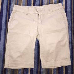 Tan/Khaki shorts They go down to about the knees, come with an extra button (as pictured), 10/10 condition and have never been worn, that's why I'm selling Arizona Jean Company Shorts