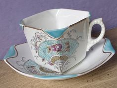 Antique English porcelain tea cup and saucer, hand painted, 1882
