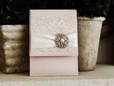 Invitation 1036: Blush Pearl, Blush Pearl, Cream Smooth, Allura, High Tower, Antique Ribbon, Cream Lace, Brooch/Buckle A6
