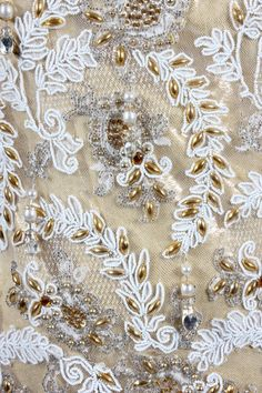 Ramon Valera cloth of gold and white lace evening gown or `Terno', Philippines, 1960s, the columnar gown embellished overall with gold elliptical beads, white seed beads and pearl droplets to the hem, with matching gold shoes