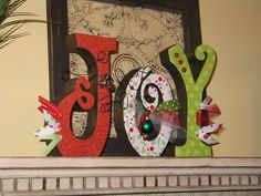 "** Christmas ""Joy"" Wooden Letters Painted, Decoupaged With Scrapbook Paper, Mini Ornaments, And Ribbon Christmas Jingles, Christmas Wood, Christmas Signs, Christmas Holidays, Christmas Ornaments, Christmas Ideas, Christmas Letters, Merry Christmas, Xmas"