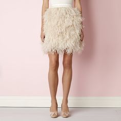 Feel like the belle of the bridal celebration in this luxurious skirt, featuring a sea of sumptuous silk-blend plumes.