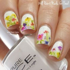 Watercolor garden themed nail art. Paint several pretty flowers on your nails in watercolor style. Use white as your background and washed out colors for the flowers and leaves such as yellow, orange, blue and pink.
