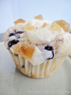 Blueberry Lemon Cream Cheese Muffins via thefrugalfoodiemama.com- moist blueberry cupcakes with a cream cheese swirled topping and candied ginger
