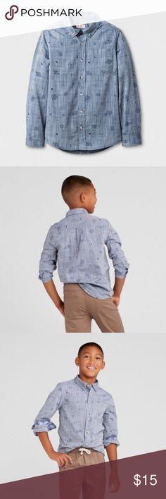 New CAT & JACK Boys Galaxy Print Chambray Shirt Boys' Long Sleeve Woven Button Down Shirt   size L (12/14) new without tags color: blue  Material: 100% Cotton  Weave: Chambray  Features: Chest patch pocket, Long sleeve, Set in sleeve, Front button down   More kid's clothes in my posh closet @cjrose25. Bundle your likes for a discount & save on shipping!! Cat & Jack Shirts & Tops Button Down Shirts