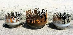 John T.Unger and he creates these fabulous fire pits from old propane gas tanks.   Repurpose, reuse, recycle.