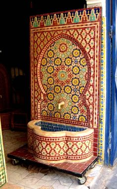 Moorish hand chiseled tile fountain, a piece of moorish achitecture history. These fountains are still used in palaces, hotels and riads in old moroccan cities wow, want one in my back yard! Moroccan Design, Moroccan Tiles, Moroccan Decor, Moroccan Furniture, Islamic Architecture, Art And Architecture, Arabesque, Style Marocain, Mosaic Tiles