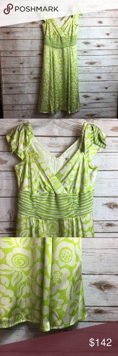 NANETTE LEPORE Silk Summer Dress NANETTE LEPORE. Bright Green and White Silk Floral Pattern. Striped Banding. Aline. 100% Silk. Bows on Shoulders. Deep Front and Back Vneck. Sleeveless. Retail $398.  Brand: Nanette Lepore Size: 4 Nanette Lepore Dresses